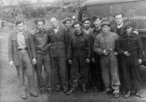 Fred Platner (far right, back row) and co-workers for the American Jewish Joint Distribution Committee; Bergen Belsen, Germany.