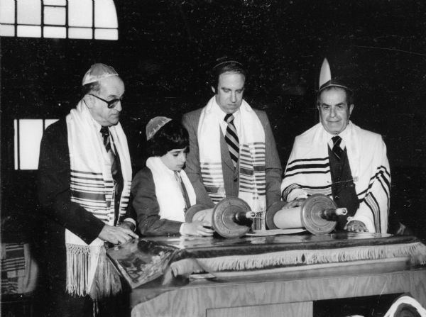 From left: Maurice Messerman, Randy Messerman, Howard Messerman, and Rabbi Mayer Relles at Randy's Bar Mitzvah at Anshe Poale Zedek Synagogue.