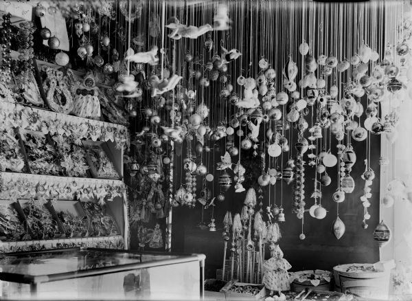 A holiday display of German-made Christmas ornaments, possibly in a store window.