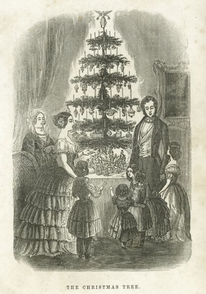 An engraving depicting a formally dressed family gathered around a Christmas tree, which is lit with candles.