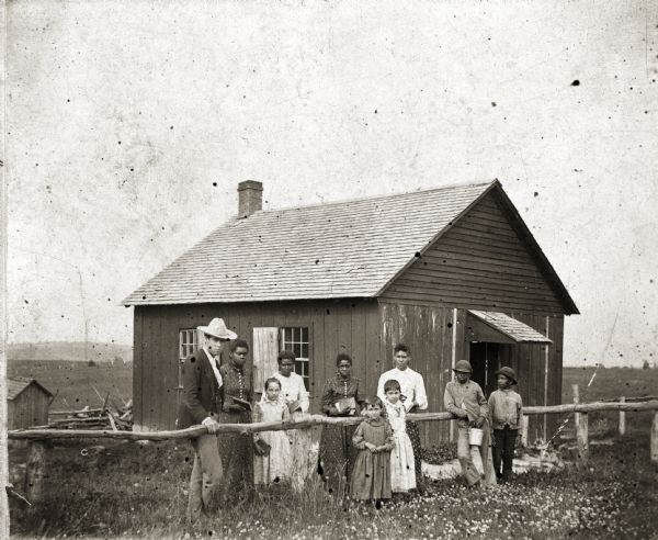 Schoolhouse of District #5 in Pleasant Ridge built on land donated by Isaac Shepard. Both blacks and whites built, attended, and taught at the school. People pictured include: F.J. Webb (teacher), Rina Gadlin, Bessie Hoffman, Nettie Gadlin, Cora Sheppard, Jennie Hoffman, May Hoffman, Emma Green, Oscar Gimes, and Lester Green.