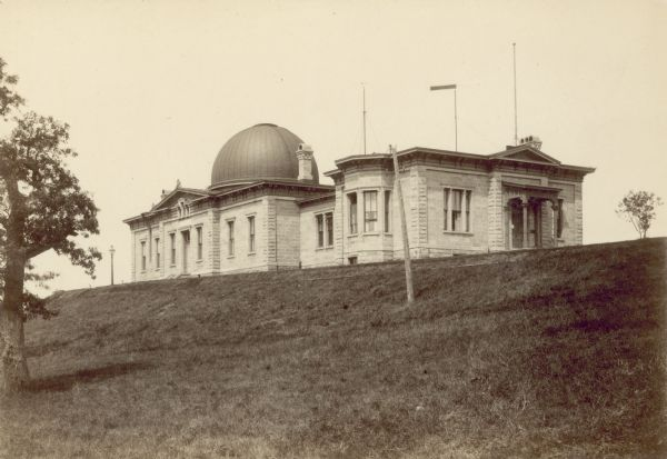 Exterior of Washburn Observatory at the University of Wisconsin-Madison, showing telephone wires.