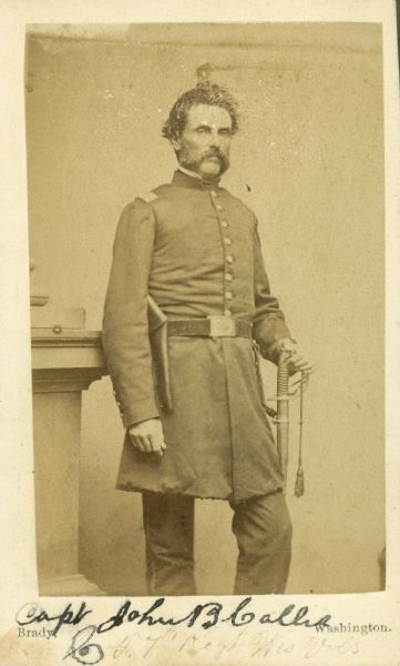 Carte-de-visite of a three-quarter length portrait of John B. Callis in uniform with a sword on his left side.