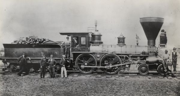 Locomotive No. 75. Class H. Built 1850 by Schnectady Locomotive Works. Men are posed on and around the locomotive.