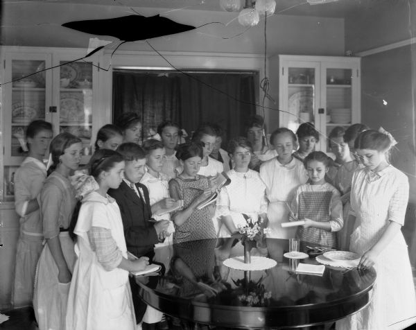 A class of girls learn how to set a table in domestic science class at the University of Wisconsin-Madison.