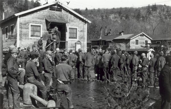 Men lined up for mealtime at the CCC (Civilian Conservation Corps) Camp at Devil's Lake State Park. The camp was reportedly opened in 1935 and closed in 1941.