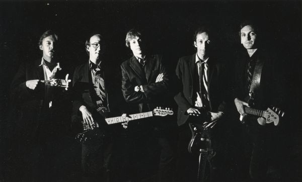 Promotional photograph of the band <i>Spooner</i>. From left: Butch Vig holding a Miller Beer bottle, Dave Benton with a guitar, Jeff Waler, Doug Erickson with a guitar, and Joel Tappero with a bass guitar.