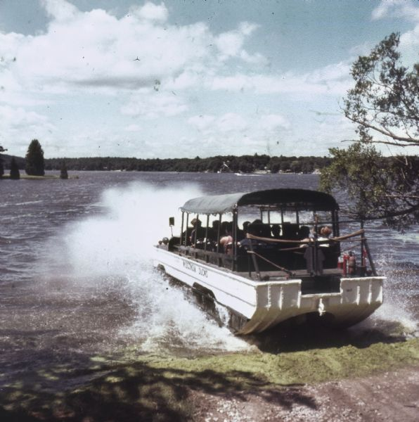 Amphibious vehicle known as a Duck splashes into Lake Delton as it carries passengers on a tour of the Wisconsin Dells.