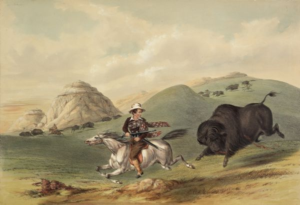 "Buffalo chasing hunter with rifle on horseback (Plate 12).<p>""The wounded and chafed bull often turns upon its assailant, and runs him back, over the whole ground; in which unpleasant reverse he has last to balance himself upon his little horse, praying for smooth ground under its feet, and deliverance from the fury that is behind him. This picturesque and jagged outline of hills only requires the background of a dark, lurid cloud; and if viewed from a distance it will need but little stretch of the imagination to conceive it to be a magnificent castle, fit for the residence of the proudest monarch on earth.""</p>"