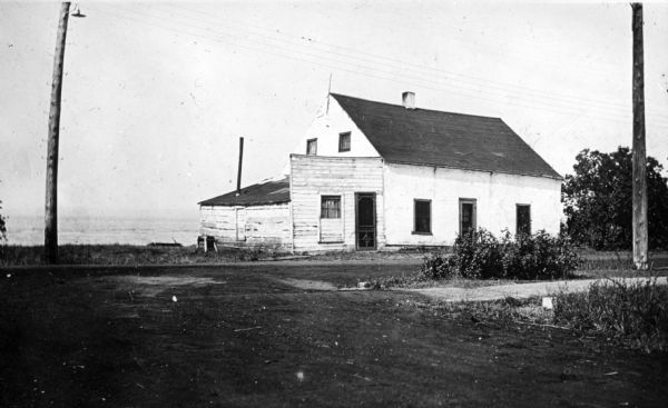 The house of Captain Angus on the shore of Lake Superior in La Pointe on Madeline Island sometime around 1900. The Angus family came to Madeline Island in 1835. The house was one of the oldest houses on Madeline Island.