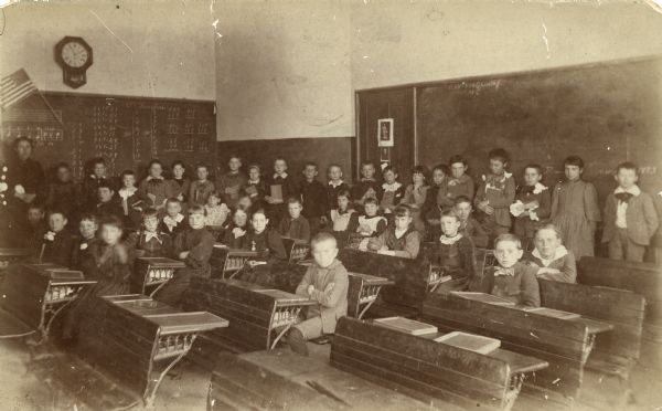 School group in classroom with teacher, possibly at Appleton, Wisconsin.