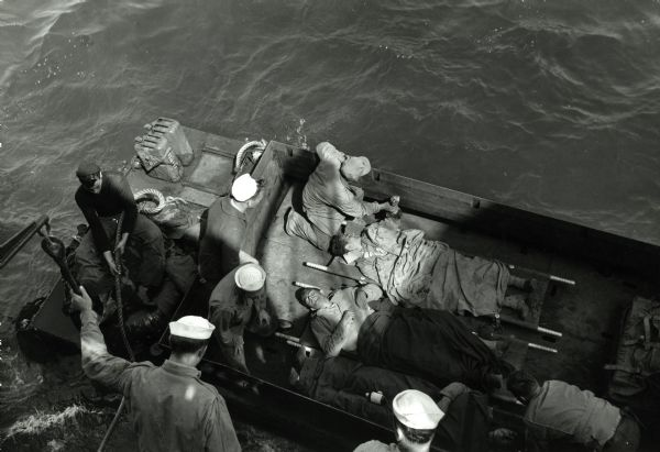 "Overhead view of wounded soldiers being transported to the USS ""Samaritan""."