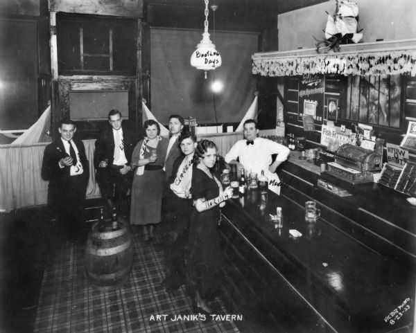 "Elevated view of six customers celebrating Bootleg Days at Arthur Janik's tavern ""The Balcony Inn"" at Lincoln and 33rd Streets. Arthur Janik was the proprietor of this establishment from 1931 to 1937."