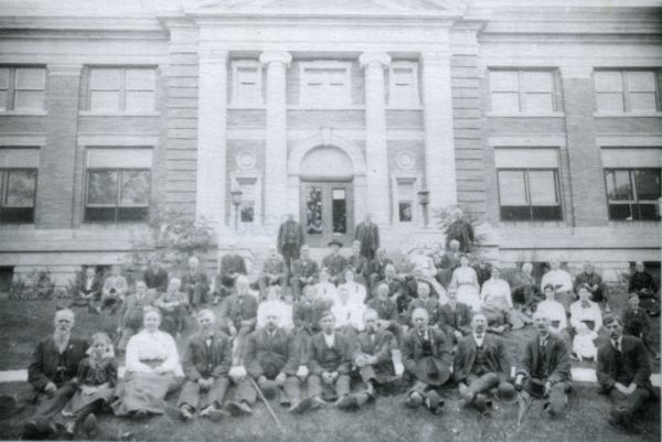 Third Wisconsin Civil War veterans' reunion, posed on the lawn in front of the Beloit Public Library.