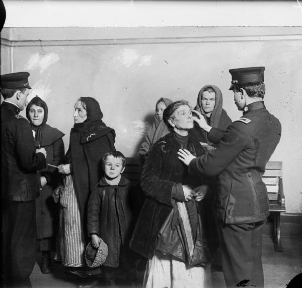 Medical inspection of immigrants at Ellis Island.