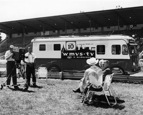The operators of the mobile unit of WMVS-TV, a community station out of Milwaukee Vocational and Adult Schools, film an interview with Roy Rogers and Dale Evans during the Wisconsin State Fair.