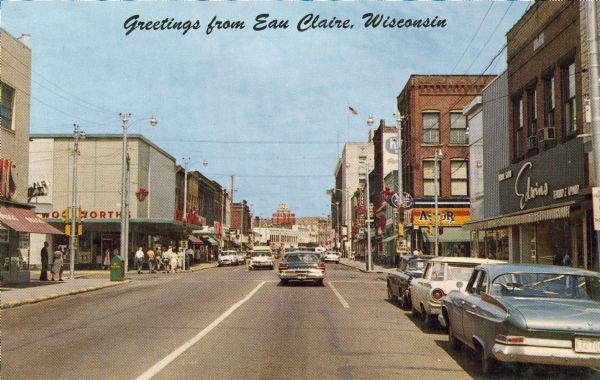 View down street of the downtown business district, including Woolworth's (left side) and Actor's Rexall Drug Store (right side).