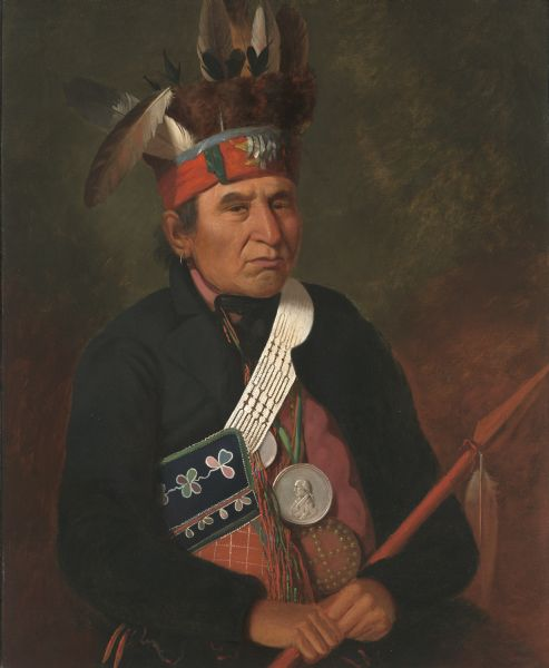 Painted portrait of Souligny, a chief of the Menominees. He is depicted wearing a James Madison Peace Medal.