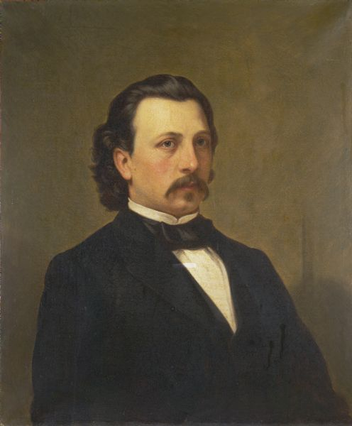 Waist-up portrait of Edward Salomon.