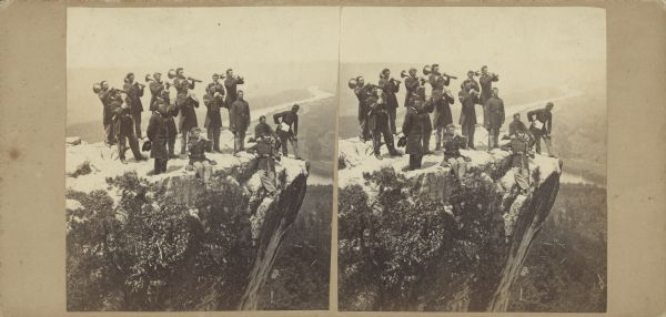 Albumen stereocard of the Union Army brass band posed and playing atop Lookout Point. The Tennessee River is in the background.