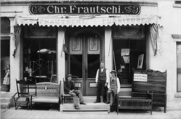 Members of the Frautschi family pose at the Christian Frautschi Furniture Store. From left to right are Alice, Irving, Christian and Arthur Frautschi.