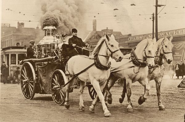 A steam fire engine of Milwaukee's Fire Company #2 drawn by three white horses racing to a fire. Prior motor driven fire equipment was a greater danger than it was during the twentieth century. Even with the best horses and equipment, fire fighters often arrived too late to save a burning building.