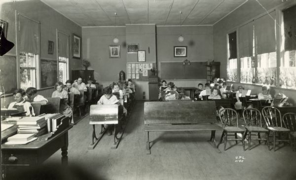 View from front of classroom of children sitting at desks at the Mendota Beach School.