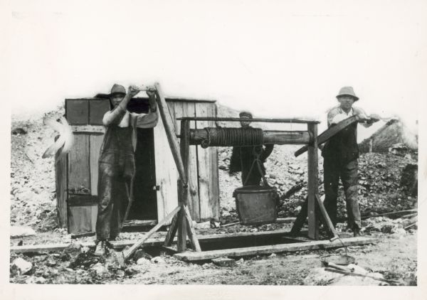 Early Wisconsin lead miners using a Pioneer Windlass.