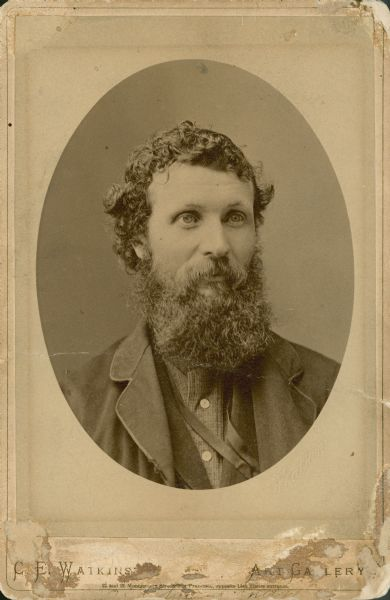 Head and shoulders oval framed portrait of John Muir (1838-1914).