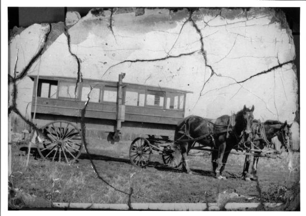 A school bus pulled by a team of horses named Colonel and Ned.