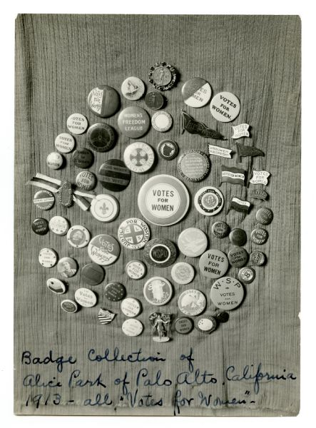 "Several buttons are arranged in a circle, all with slogans, photographs, or symbols related to women's suffrage. Caption reads: Badge collection of Alice Park of Palo Alto, California, 1913 — all ""Votes for Women."""