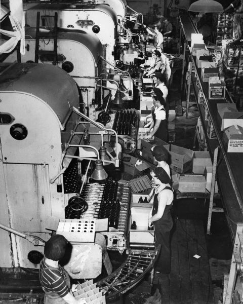 Elevated view of workers on the bottling line at the Schlitz Brewery.